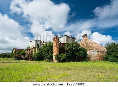 Old and abandoned buildings used for sugar cane in Koloa sugar mill on Hawaiian island of Kauai