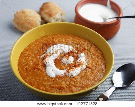 Lentil cream soup with paprika and yogurt