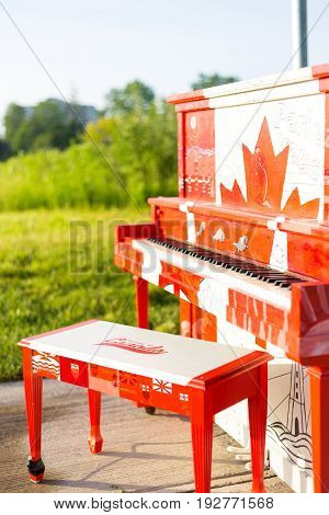 London Ontario Canada-June 3 2017: The Hyde Park outdoor Piano painted by the students of Oakridge secondary school in the theme of our Canadian 150 year celebration. The piano is left outside for the summer.