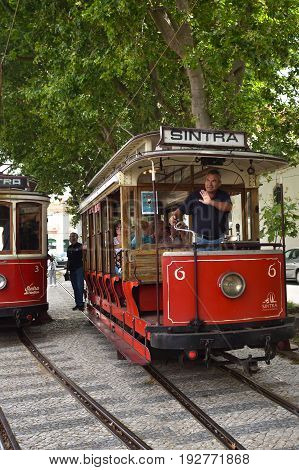 Sintra Street Scene With Old Red Trams