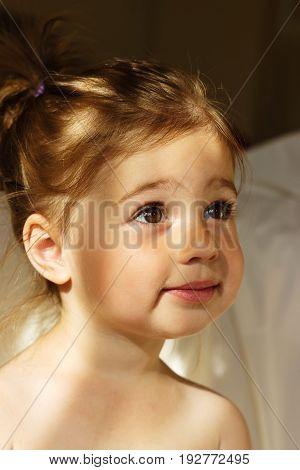 Portrait of a cute preschool girl smiling