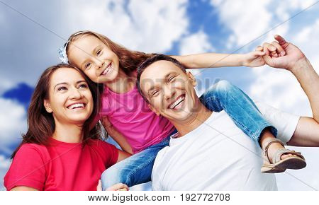 Happy smiling family daughter elementary age pre-adolescent child fun