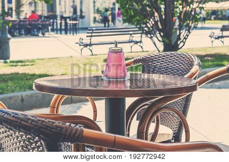 Cafe table outdoor on sunny day in town center