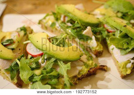 whole wheat bread slice with avocado and radish