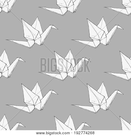 Hand drawn origami cranes on a gray background, monochrome vector seamless pattern