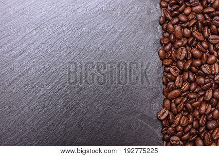 Stony Black Board Sprinkled With Nearby Grain Roasted Coffee, Place For Tex, Background And Texture