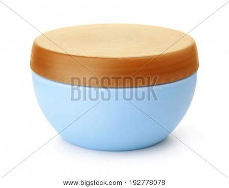 Blue plastic cosmetic jar isolated on white