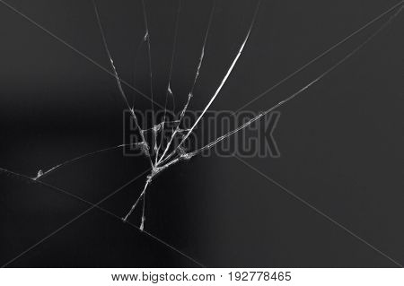 Crack on the glass of a smartphone or tablet result of a fall shock or damage.