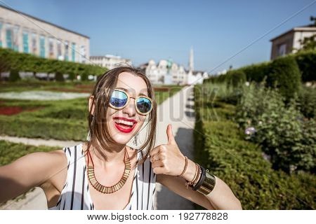 Young woman making selfie photo standing on the arts mountain in Brussels