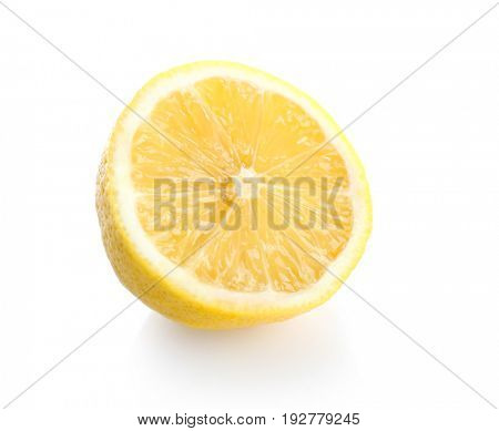 Half of fresh ripe lemon on white background