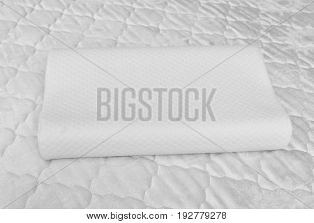 Orthopedic pillow on white mattress. Physiotherapy concept