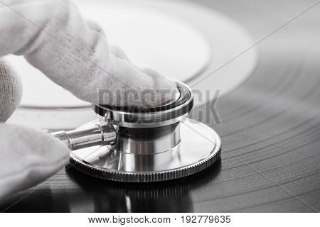 Concept of connoisseur of old music on vinyl with analog sound old school.