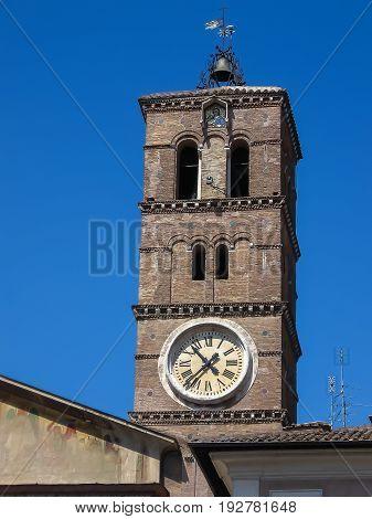 The campanile of the Basilica of Santa Maria in Trastevere in a sunny day (Rome, Italy)