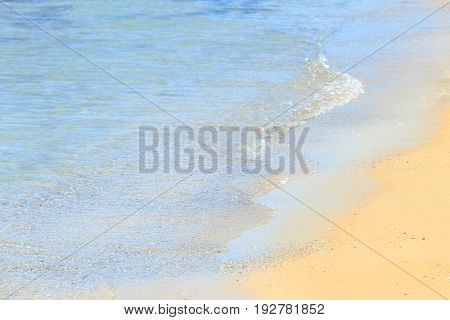 Warm sand and sea waves on beach