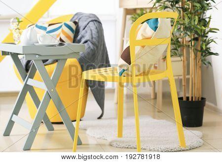 Cozy chair and coffee table in beautiful veranda interior