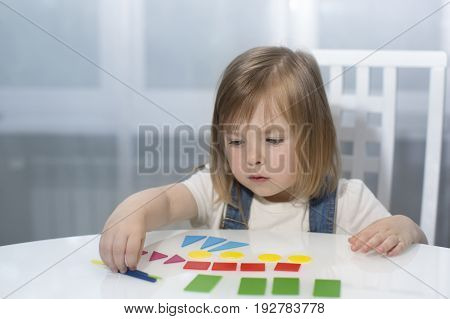 A Little Girl Remembers Geometric Shapes. Early Education Horizontal. Toned