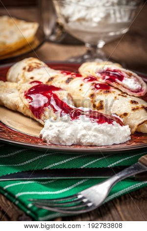 Rolled Crepes Stuffed With Cottage Cheese.