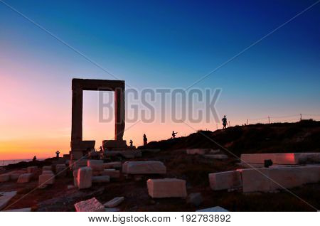 Portara ruins entrance of ancient temple of Apollo at sunset on Naxos island Greece