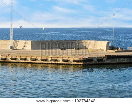 Pier in the Gulf of Finland with an old cannon and an anchor
