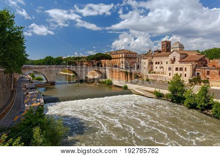View of the island of Tiberin and the Tiber River on a sunny day. Italy. Rome.