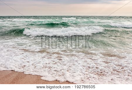 Sea ​​waves Running On Sandy Beach