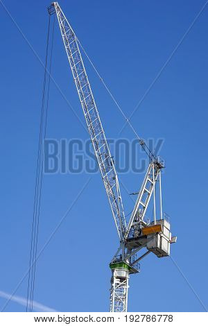 construction tower crane detail against blue sky .
