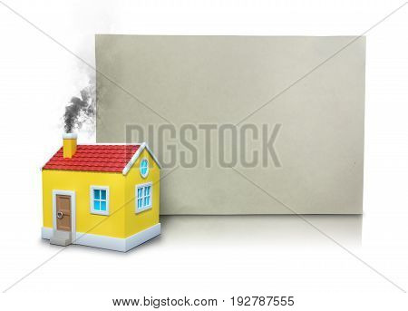 Digital composite image of smoke emitting from model home chimney by blank placard against white background