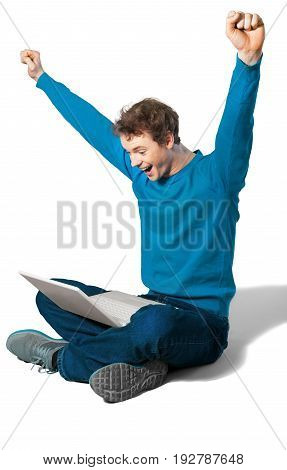 Happy sitting young man laptop white blue