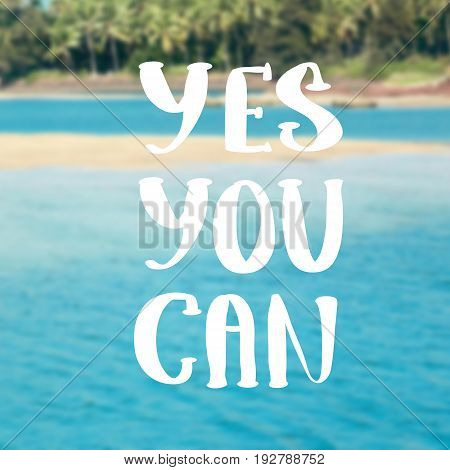 Yes You Can. Inspirational quote on blurred landscape background
