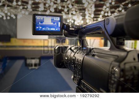 Digital video camera shoots meeting - 3CCD Camcorder recording in TV studio