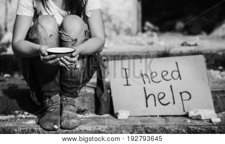 Poverty concept. Poor woman begging for money on street