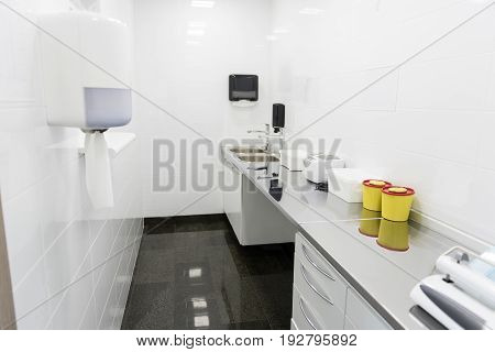 Design of sterile white apartment in dental clinic. Different equipments locating on table in it