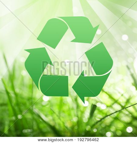 Concept of environmental conservation and protection. Symbol of recycling and green grass on background