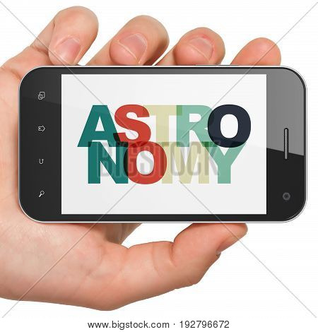Learning concept: Hand Holding Smartphone with Painted multicolor text Astronomy on display, 3D rendering