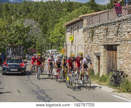 Mont Ventoux France - July 142016: The peloton (gruppetto) riding on the road to Mont Ventoux during the stage 12 of Tour de France 2016.