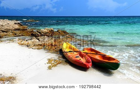 holiday beach with boat sea and sky.