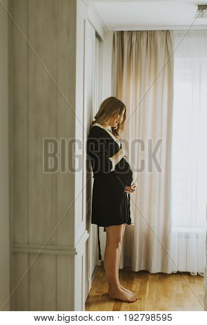 Pregnant Woman Wearing Lingerie And Posing In The Room