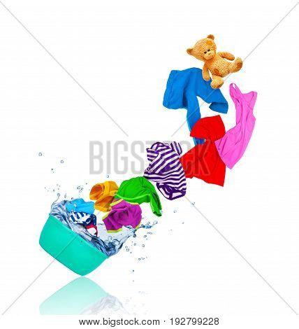 Colorful clothes flying out from wash bowl isolated on white background
