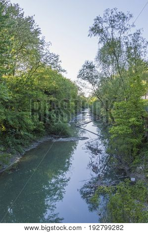 Italy small river floating in a beautiful landscape on Appennino hills