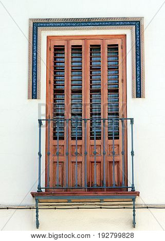 Beautiful window with shutters and small balcony in the town of Dos Hermanos, Andalusia, Spain