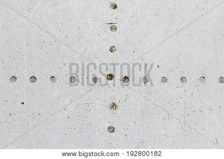Old aluminum background detail of a military aircraft surface corrosion. Oxidized metal texture with rivets.