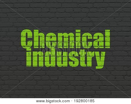 Manufacuring concept: Painted green text Chemical Industry on Black Brick wall background