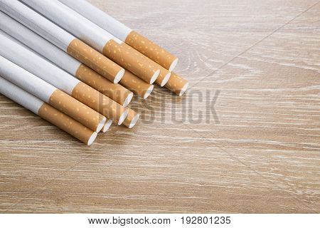 Cigarettes On Brown Background