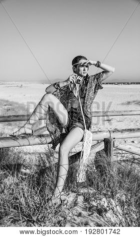 Bohemian Girl With Retro Photo Camera Looking Into The Distance