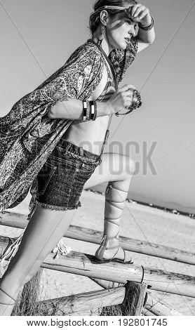 Trendy Bohemian Chic Outdoors With Retro Photo Camera