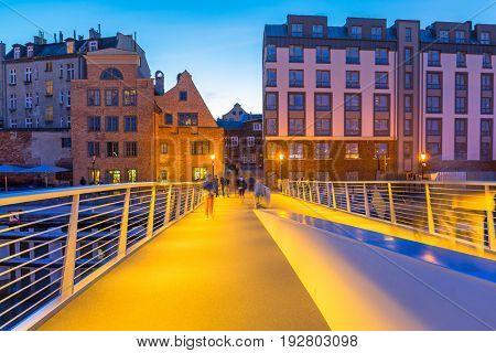 New catwalk over Motlawa river in Gdansk at dusk, Poland