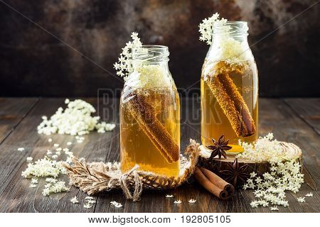 Homemade fermented cinnamon and ginger kombucha tea infused with elderflower. Healthy natural probiotic flavored drink. Copy space