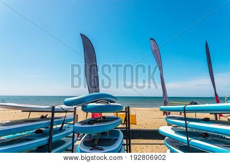 Sandy Beach, Color Kayaks Based On Stand, In Background Beautiful View On Blue Ocean