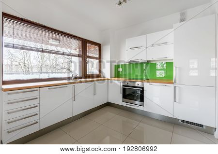 Modern, White Kitchen With Window