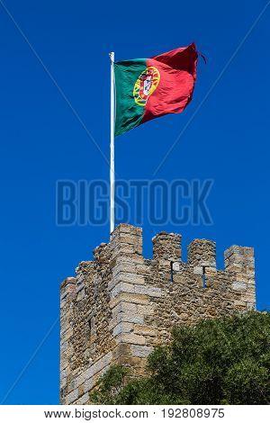 Guard Castle Tower Castelo De S. Jorge With The Portuguese Flag, Lisbon